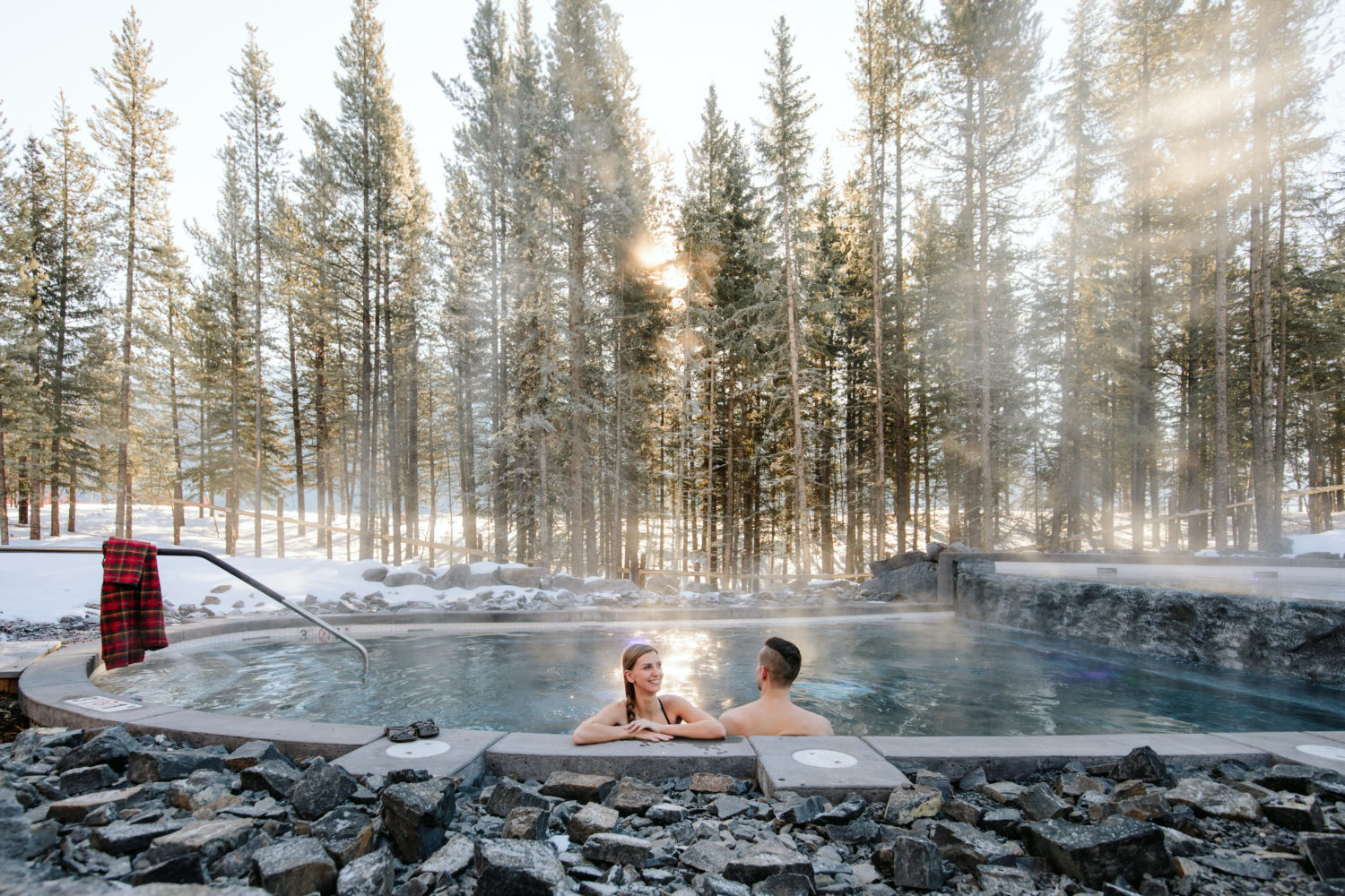 nordic-spa-couple-outside-pool-daytime-2-e1531856982656